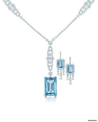 Колье и серьги из платины с бриллиантами и аквамаринами изумрудной огранки, в том числе центральным камнем весом 49,59 карата