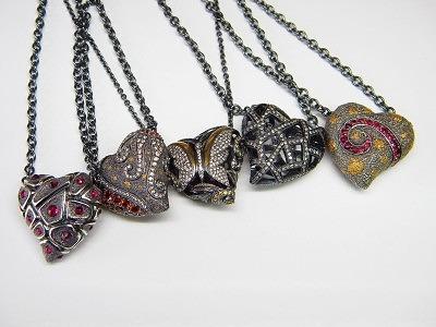 Серия колье с сердцами «Love» из окисленного серебра со вставками из 24-каратного золота, рубинами, белыми, черными и голубыми бриллиантами, а также желтыми и оранжевыми сапфирами, Rhyme & Reason