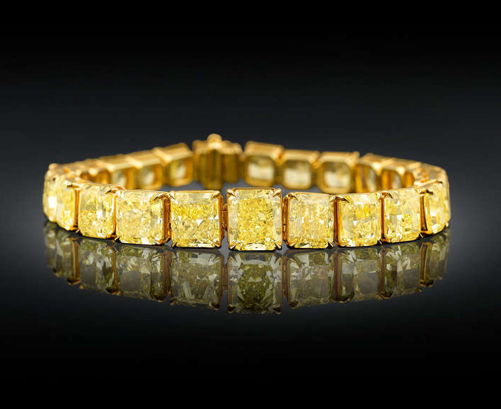 1_Natural-Fancy-Vivid-Yellow-Diamond-Bracelet-1-e1398799302360