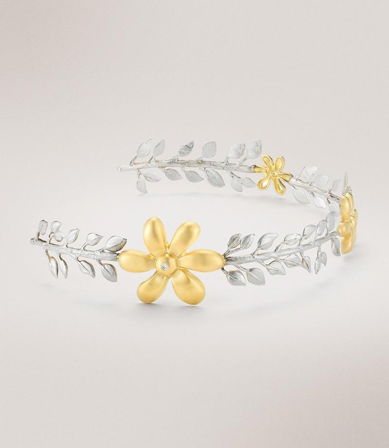 Ободок из серебра и желтого золота с бриллиантами.