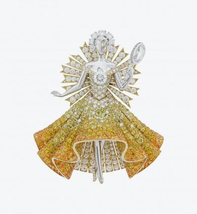 Брошь из желтого и белого золота Sun Dress с белыми и желтыми бриллиантами, гранатами, турмалинами и желтыми сапфирами.