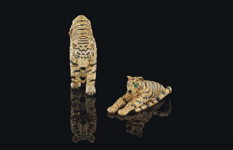 Браслет и брошь с тиграми с бриллиантами, ониксом и изумрудами, принадлежавшие герцогине Виндзорской и Саре Брайтман.