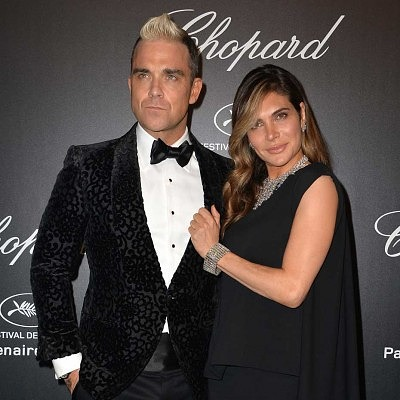 Робби Уильямс посетил «Золотую вечеринку» со своей женой Айдой, которая также подобрала к своему наряду бриллиантовые украшения Chopard