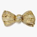 Золотая брошь-бант от Van Cleef & Arpels
