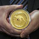 Rio Tinto продадут монету с красным бриллиантом