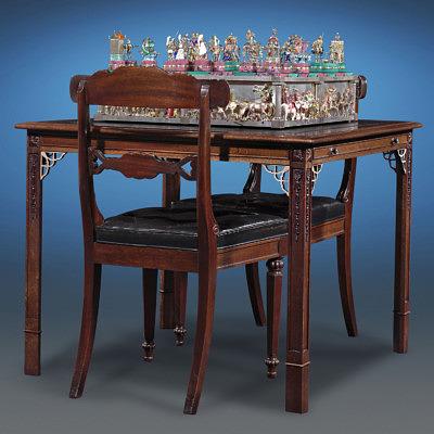 Стол и стулья из красного дерева идут вместе с шахматным набором The Battle of Issus Chess Set