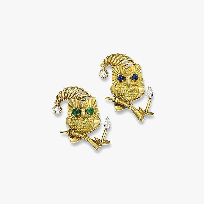 Пара золотых брошей-совят от Cartier