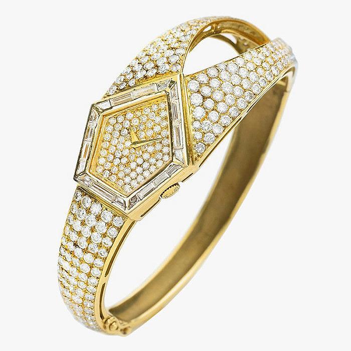 Часы-браслет из золота с бриллиантами от Chopard