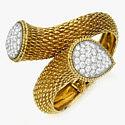 Необычный золотой браслет с бриллиантовым паве от Boucheron