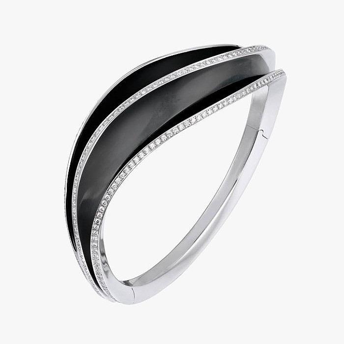 Белое золото, черня эмаль и бриллианты в браслете Cartier